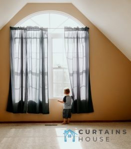 child-holding-curtain-curtains-house-singapore_wm